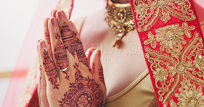 Buy stock photo Cropped shot of an unrecognizable young woman praying on her wedding day