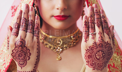 Buy stock photo Cropped studio shot of an unrecognizable woman with mehendi painted on her hands on her wedding day
