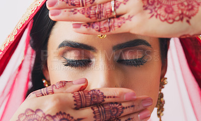 Buy stock photo Cropped shot of a beautiful young woman covering her face with her hands on her wedding day