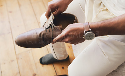Buy stock photo Cropped shot of an unrecognizable man putting on a watch in preparation for his wedding