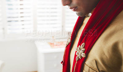 Buy stock photo Cropped shot of a young man getting dressed on his wedding day
