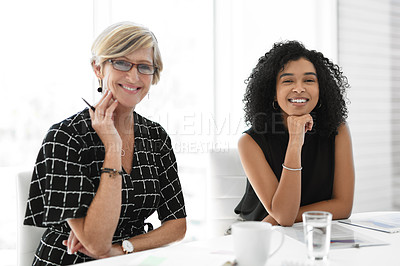Buy stock photo Cropped portrait of two businesswomen sitting in a modern office