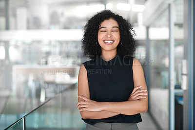 Buy stock photo Cropped portrait of an attractive young businesswoman standing with her arms crossed in a modern office