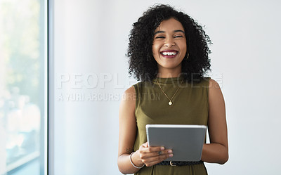 Buy stock photo Cropped portrait of an attractive young businesswoman holding a digital tablet while standing in a modern office