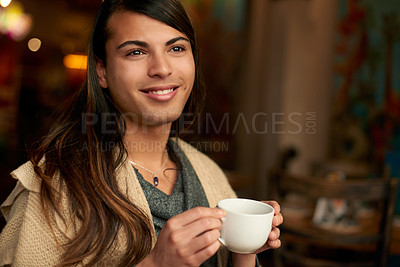 Buy stock photo Cropped shot of a young gender fluid person looking thoughtful while having coffee in a cafe