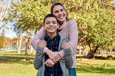 Buy stock photo Shot of a young boy spending quality time with his mother at the park