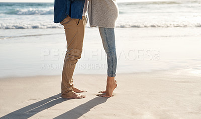 Buy stock photo Cropped shot of an unrecognizable couple spending quality time together on the beach