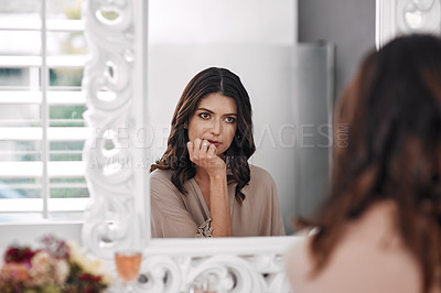Buy stock photo Cropped shot of a beautiful woman admiring herself in the mirror at home