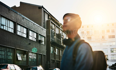Buy stock photo Cropped shot of a handsome young man walking through the city