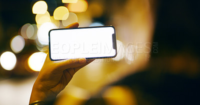 Buy stock photo Cropped shot of an unrecognizable businesswoman standing outside alone at night and showing her cellphone screen