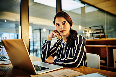Buy stock photo Portrait of a young businesswoman working in an office at night