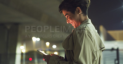 Buy stock photo Cropped shot of an attractive young businesswoman standing alone and texting on her cellphone after working a late shift