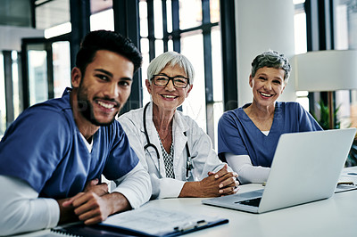 Buy stock photo Portrait of a team of medical professionals having a meeting together inside a hospital boardroom