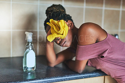 Buy stock photo Cropped shot of a young woman busy cleaning her home