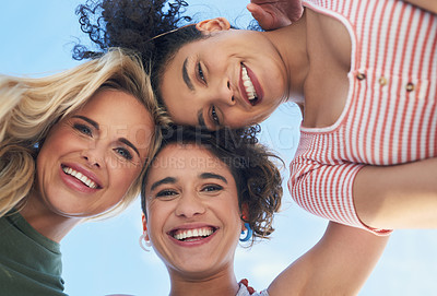 Buy stock photo Shot of three female friends smiling down at the camera