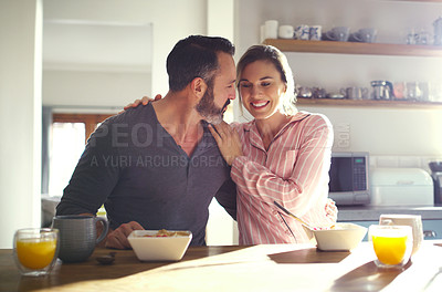 Buy stock photo Cropped shot of a middle aged couple having breakfast at home