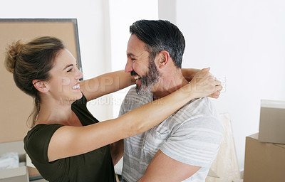 Buy stock photo Cropped shot of a middle aged couple moving into their new home