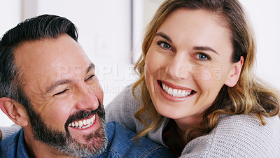 Buy stock photo Cropped shot of an affectionate couple relaxing together at home