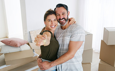 Buy stock photo Shot of a couple holding the key to their new home