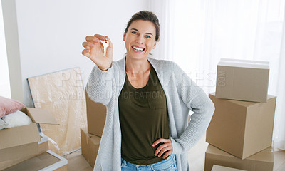 Buy stock photo Shot of a middle aged woman holding the key to her new home