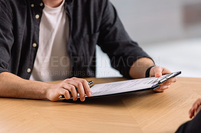 Buy stock photo Closeup shot of two businesspeople going through paperwork in an office