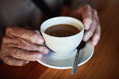 Buy stock photo High angle shot of an unrecognizable senior man drinking coffee in a cafe