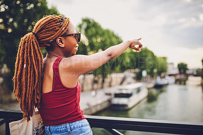 Buy stock photo Shot of a young woman touring the city of
