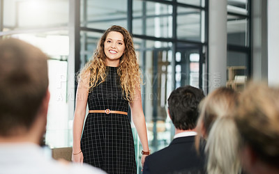 Buy stock photo Shot of an attractive young woman giving a speech and explaining her ideas at a business conference
