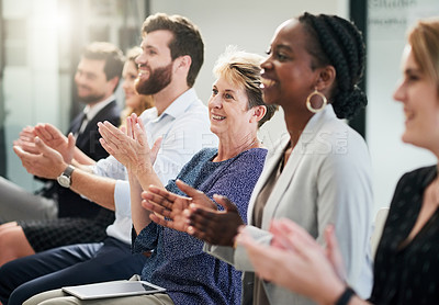 Buy stock photo Shot of a mature businesswoman clapping and celebrating with other entrepreneurs at a business conference