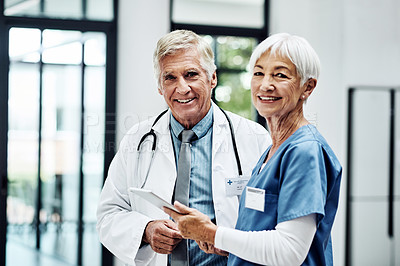 Buy stock photo Portrait of two medical practitioners working together in a hospital