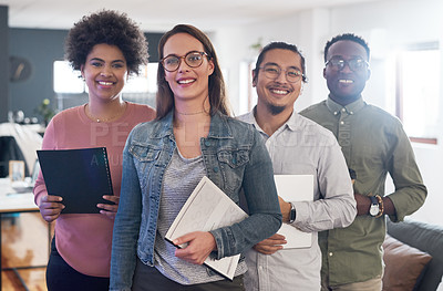 Buy stock photo Portrait of a group of confident young businesspeople working in a modern office