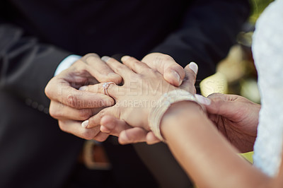 Buy stock photo Cropped shot of a couple exchanging rings on their wedding day