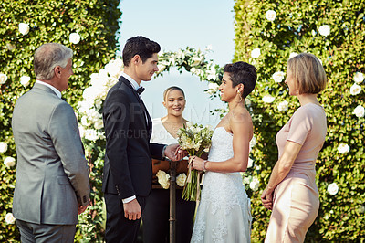 Buy stock photo Shot of a happy young couple getting married in a garden