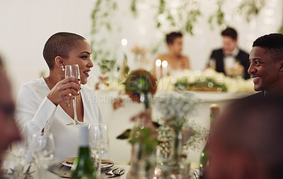 Buy stock photo Shot of young wedding guests having wine together at a wedding reception