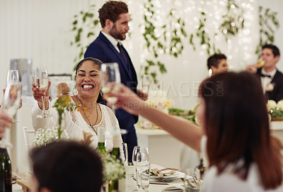 Buy stock photo Shot of a group of wedding guests toasting with wine at a wedding reception