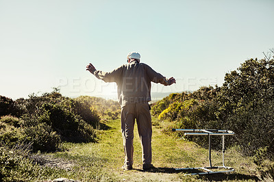 Buy stock photo Rearview shot of an unrecognizable senior man throwing his walker aside while out for a stroll outdoors