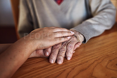 Buy stock photo High angle shot of an unrecognizable senior man being consoled by a woman in his home