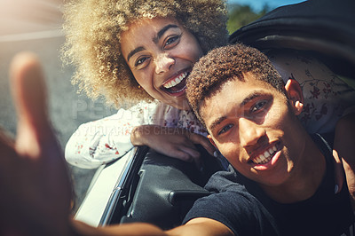 Buy stock photo Cropped shot of a happy young couple out on a road trip