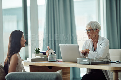 Buy stock photo Cropped shot of a confident mature doctor consoling a patient inside of a doctor's office during the day