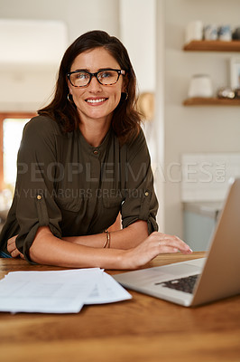 Buy stock photo Cropped portrait of an attractive young woman smiling while using a laptop to work from home