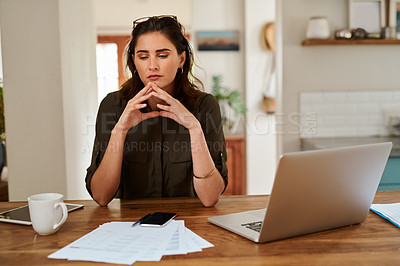 Buy stock photo Cropped shot of an attractive young woman looking thoughtful while working from home