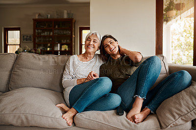 Buy stock photo Full length portrait of an affectionate young woman spending time with her elderly mother in their living room at home