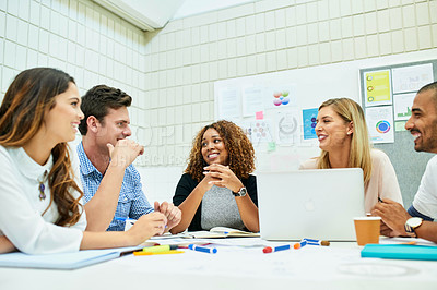 Buy stock photo Shot of a group of young designers having a meeting together in their office