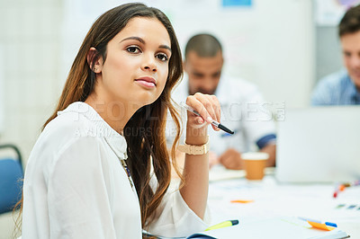 Buy stock photo Portrait of an attractive young designer having a meeting with her colleagues at work
