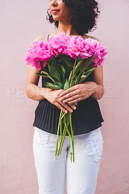 Buy stock photo Cropped shot of an unrecognizable woman holding a bouquet while posing against a pink background