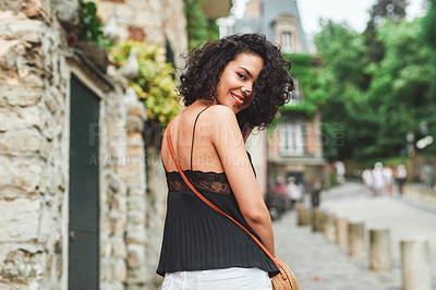 Buy stock photo Shot of an attractive young woman out exploring a foreign city