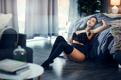 Buy stock photo Shot of a beautiful young woman wearing lingerie at home