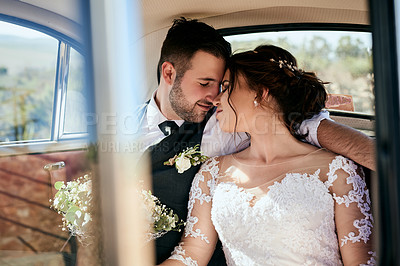 Buy stock photo Shot of a young couple travelling in a car on their wedding day