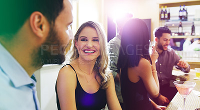 Buy stock photo Shot of a young man and woman chatting in a nightclub
