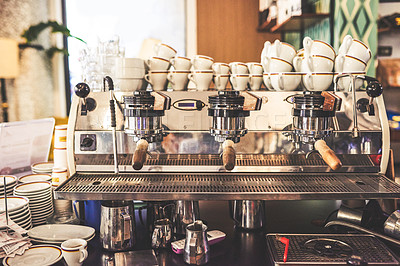 Buy stock photo Shot of a coffee machine ready to be used to pour coffee for customers inside of a cafe during the day